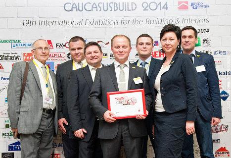 на фото : представители компании DOKA и Александр Вершков (в центре)