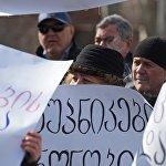 На акции прозвучали требования об отставке Георгия Маргвелашвили с поста президента страны, а также о роспуске действующего парламента.