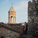 Туристы в городе Сигнахи