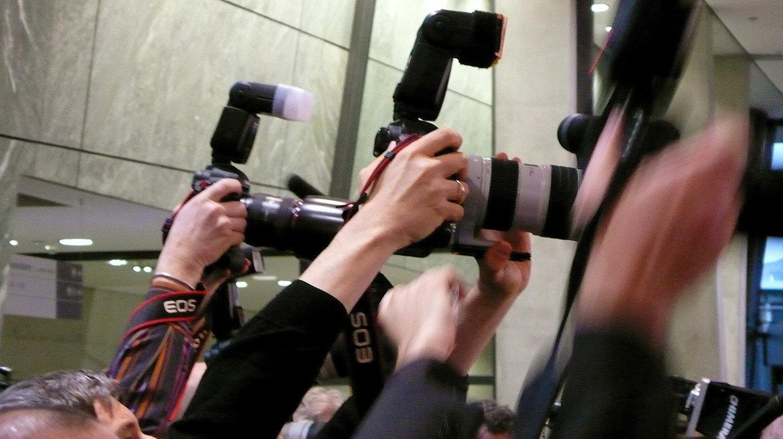 Фоторепортеры на пресс-конференции