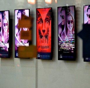 Киноафиша в кинотеатре