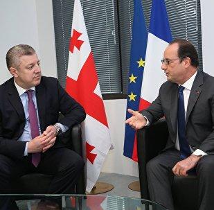 Георгий Квирикашвили и Франсуа Олланд