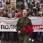 Участники шествия на акции Бессмертный полк в честь празднования 71-й годовщины Победы в Великой Отечественной войне в Бишкеке. В мероприятии приняли участие около 20 тысяч человек. Табылды не смог пропустить такое событие