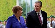Ангела Меркель и Георгий Квирикашвили