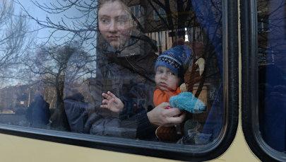 Беженцы в салоне автобуса