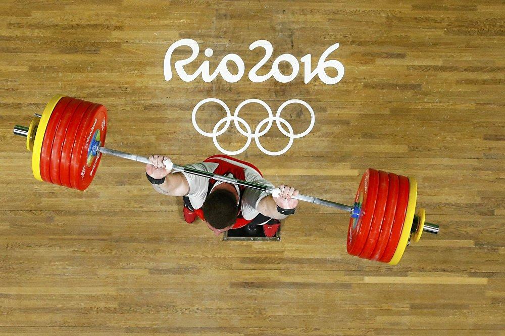 Лаша Талахадзе завоевывает золотую медаль на Олимпиаде в Рио.
