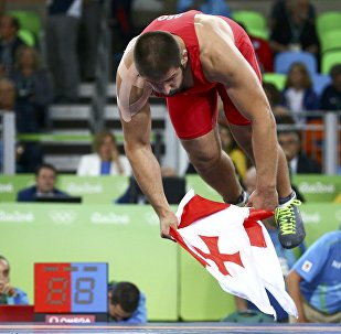 Geno Petriashvili (GEO) of Georgia celebrates winning the bronze medal.