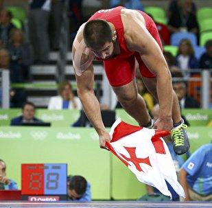 Geno Petriashvili (GEO) of Georgia celebrates winning the bronze medal.