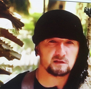 Кадр из видеоролика, в котором Гулмурод Халимов заявил о присоединении к ИГ