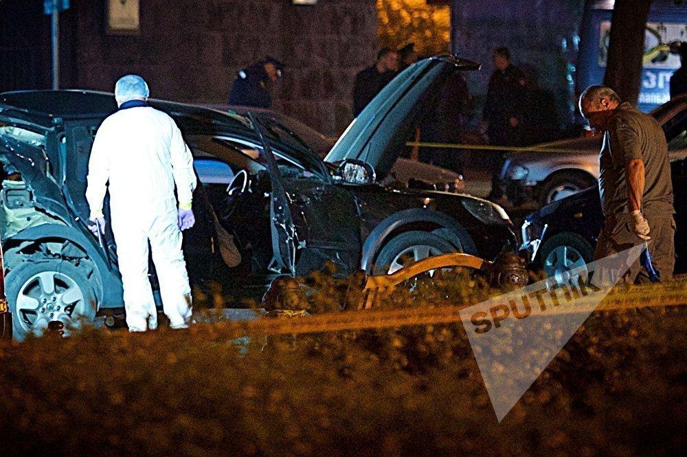 Криминалисты работают на месте взрыва в центре грузинской столицы