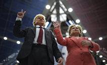 Изображающие Хиллари Клинтон и Дональда Трампа куклы