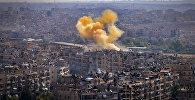 Разрушенные дома на севере сирийского города Алеппо после боев с боевиками ИГ