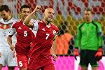 Полузащитник сборной Грузии Джаба Канкава празднует после выигрыша во время отборочного футбольного матча между командами Германии и Грузии в Лейпциге на Евро-2016 Группа D