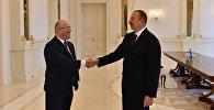 Министр обороны Грузии Леван Изория и президент Азербайджана Ильхам Алиев