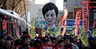 Сотни тысяч митингующих на улицах Сеула требуют отставки президента Южной Кореи