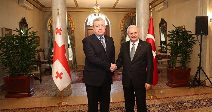 Георгий Квирикашвили и Бинали Йылдырым