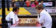 Грузинский шахматист Леван Панцулая и чемпион мира Магнус Карлсен