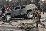 Полиция Афганистана осматривает место взрыва в Кабуле