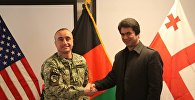 Вице-полковник ВС Грузии Роман Саникидзе и глава уезда Карабаг в Афганистане Абдул Сени Шариф