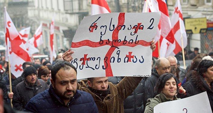 Схваченные вТбилиси сторонники Саакашвили освобождены под подписку оневыезде