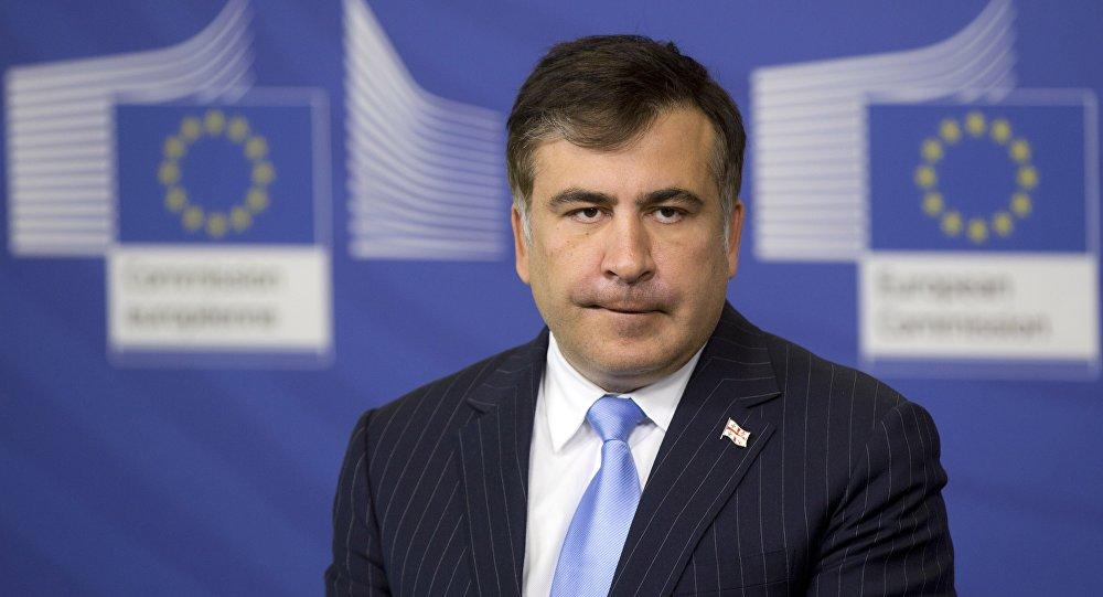 Бывший президент Грузии Михаил Саакашвили слушает вопросы журналистов в здании ЕС в Брюсселе, архив 2013 года