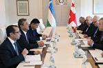Премьер Грузии Георгий Квирикашвили и первый заместитель главы сената парламента Узбекистана Содик Сафоев
