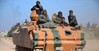 Бойцы повстанцев, входящие в поддерживаемый Турцией союз Щит Евфрата, продвигаются в направлении города Аль-Баб, примерно в 30 километрах от сирийского города Алеппо