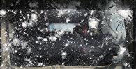 ტყვიების კვალი ერაყის ფედერალური პოლიციის ბრონირებული მანქანის საქარე მინაზე