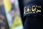 Палестинская женщина, одетая в повязку «Исламский джихад»
