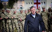 Премьер-министр Грузии Георгий Квирикашвили во время посещения военной базы