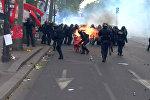 столкновения протестующих с полицией 1 мая в Париже