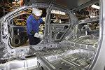 Сборка электромобилей на заводе по производству машин в Малайзии