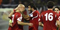Игроки сборной Грузии радуются после забитого гола в матче против команды Германии