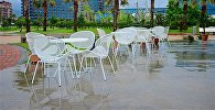 Безлюдное кафе на набережной Батуми после дождя