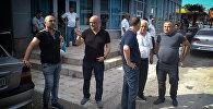 Представители краевой администрации у вещевого рынка Поти, где был пожар