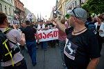 Защити Грузию!: как в Тбилиси протестовали против нелегальных мигрантов