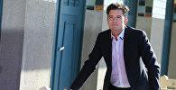 Британский актер Орландо Блум позирует во время открытия своего выделенного отсека для пляжа на французском северо-западном морском курорте Довиль в кулуарах 41-го Дойлинского кинофестиваля в Довиле
