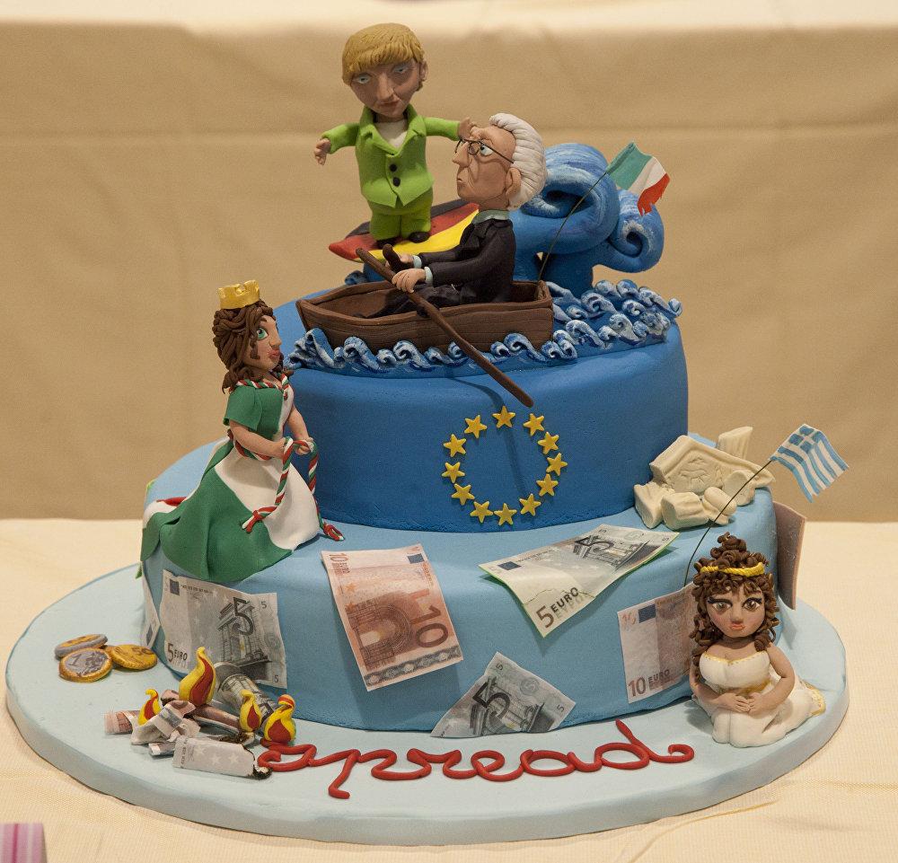 Торт с фигурками итальянского сенатора Марио Монти и канцлера Германии Ангелы Меркель на выставке шоколадной продукции в Неаполе