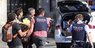 Полицейские и спасатели уносят пострадавшего с места наезда на людей в центре Барселоны