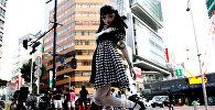 Модель «Кукла» Лулу Хашимото позирует фотографу