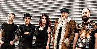 Лондонская рок-группа Kiss The Gun и ее солистка Надин Захарян