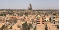Вид на район Джафра в Дейр-эз-Зоре, где продолжаются бои между сирийской армией и боевиками запрещенной в России организации ИГИЛ