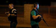 Полицейские на месте стрельбы