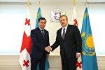 Премьер-министр Грузии Георгий Квирикашвили и министр развития и инвестиций Казахстана Женис Касымбек