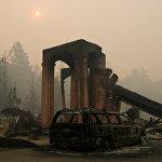 Масштабы бедствия просто ужасают - по штату зарегистрировано 22 крупных очага лесных пожаров. Огонь уничтожает все на своем пути