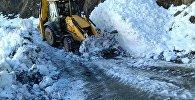 Работы по очистке дороги от снега