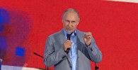 Как Путин обратился к участникам ВФМС по-русски и по-английски
