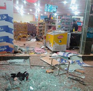 Разрушенный землетрясением магазин в Ираке