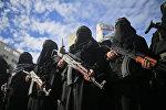 Вооруженные автоматами Калашникова женщины, входящие в боевую палестинскую группу Исламский джихад, принимают участие в акции протеста в городе Газа против решения президента США Дональда Трампа признать Иерусалим столицей Израиля