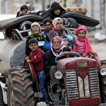 Жители деревни Халди в восточной части Африна, Сирия, покидают населенный пункт, захваченный сирийскими формированиями Free Syrian Army fighters, которых поддерживает турецкая сторона